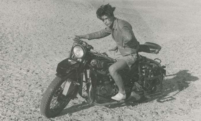 Tough guy posing on Arthur Staal's motorcycle during his tour through the British protectorate Palestine in 1939